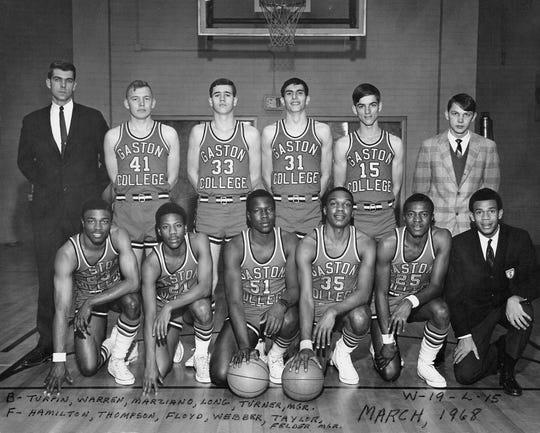 A team photo of the Gaston College basketball team with FSU head coach Leonard Hamilton (23) on the left side of the front row.