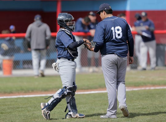 Coronado catcher talks with pitcher Lorenzo Romero as they try to close out their game against Chapin Friday in the SISD Baseball Tournament.