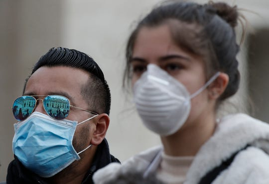 The faithful wear face masks in St. Peter's Square at the Vatican during Pope Francis' weekly general audience Wednesday, Feb. 26, 2020. The viral outbreak that began in China has infected more than 80,000 people globally, and so far has caused 323 cases and 11 deaths in Italy.