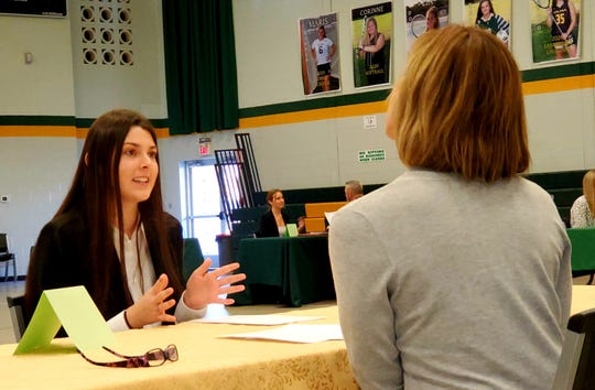 Lisa Trabuchi, a physical therapist with Bayada, interviews Trinity Miskelly of Millville, a junior at Our Lady of Mercy Academy, during Mock Interview Day, part of a series of programs at the academy which help students prepare for college and beyond.