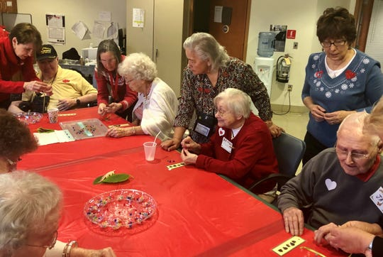 (Standing, from left) Jan Lobiondo, Susan Bradbury, Lynn Houck and Marianne Bagliani, members of the Rutgers Master Gardeners of Cumberland County horticulture enrichment team, visited the New Jersey Veterans Memorial Home in Vineland to share a bookmark project with residents.