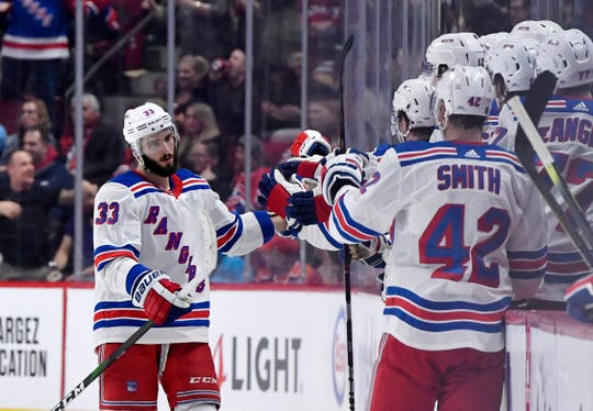 Feb 27, 2020; Montreal, Quebec, CAN; New York Rangers forward Phillip Di Giuseppe (33) reacts with teammates after scoring a goal against the New York Rangers during the second period at the Bell Centre. Mandatory Credit: Eric Bolte-USA TODAY Sports