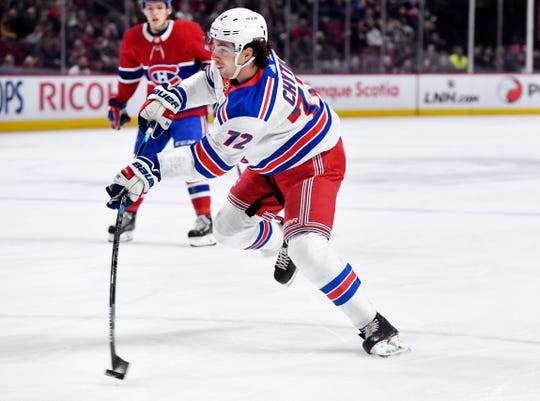 Feb 27, 2020; Montreal, Quebec, CAN; New York Rangers forward Filip Chytil (72) takes a shot on net during the first period of the game against the Montreal Canadiens at the Bell Centre. Mandatory Credit: Eric Bolte-USA TODAY Sports