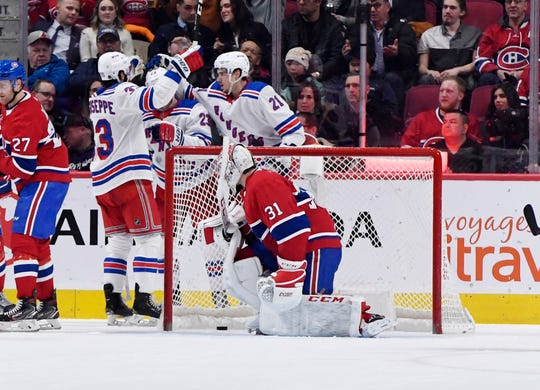 Feb 27, 2020; Montreal, Quebec, CAN; New York Rangers forward Phillip Di Giuseppe (33) reacts with teammates after scoring a goal against Montreal Canadiens goalie Carey Price (31) during the second period at the Bell Centre. Mandatory Credit: Eric Bolte-USA TODAY Sports