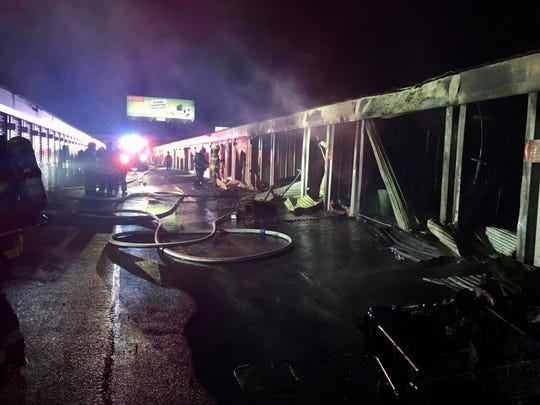 A two-alarm fire early Friday damaged a dozen units at a Bear storage unit facility.