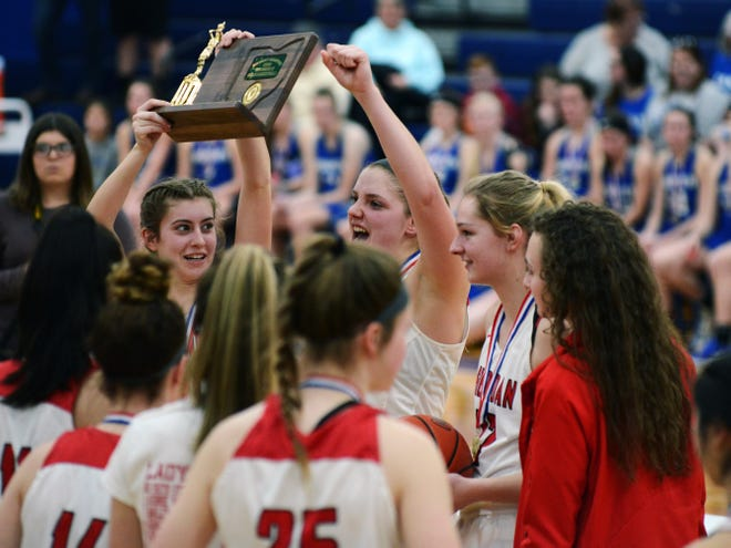Sheridan celebrates with the championship trophy following a 45-39 win against Vincent Warren in a Division II district final on Thursday at Chillicothe Southeastern.