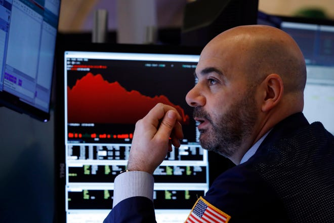 Trader Fred DeMarco works on the floor of the New York Stock Exchange, Friday, Feb. 28, 2020. Global stock markets are falling further on spreading coronavirus fears.