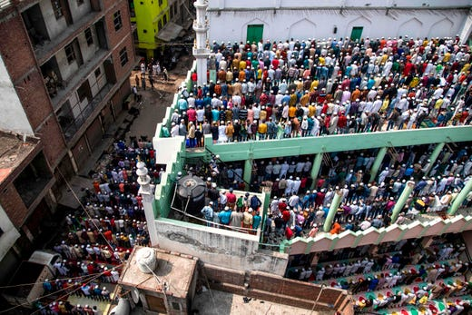 Muslim devotees offer Friday prayers at a mosque following sectarian riots over India's new citizenship law in New Delhi on Feb. 28, 2020.  Muslims in India's capital held regular prayers under the watch of riot police, capping a week which saw 42 killed and hundreds injured during the city's worst sectarian violence in decades.