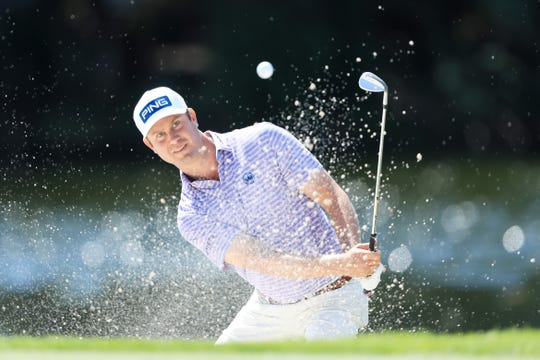 Harris English of the United States plays a shot from a bunker on the sixth hole during the first round of the Honda Classic at PGA National Resort and Spa Champion course in Palm Beach Gardens, Fla.