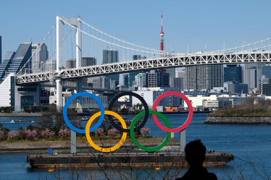 """The International Olympic Committee is """"committed"""" to holding the 2020 Games in Tokyo as planned despite the widening new coronavirus outbreak, president Thomas Bach said Friday."""