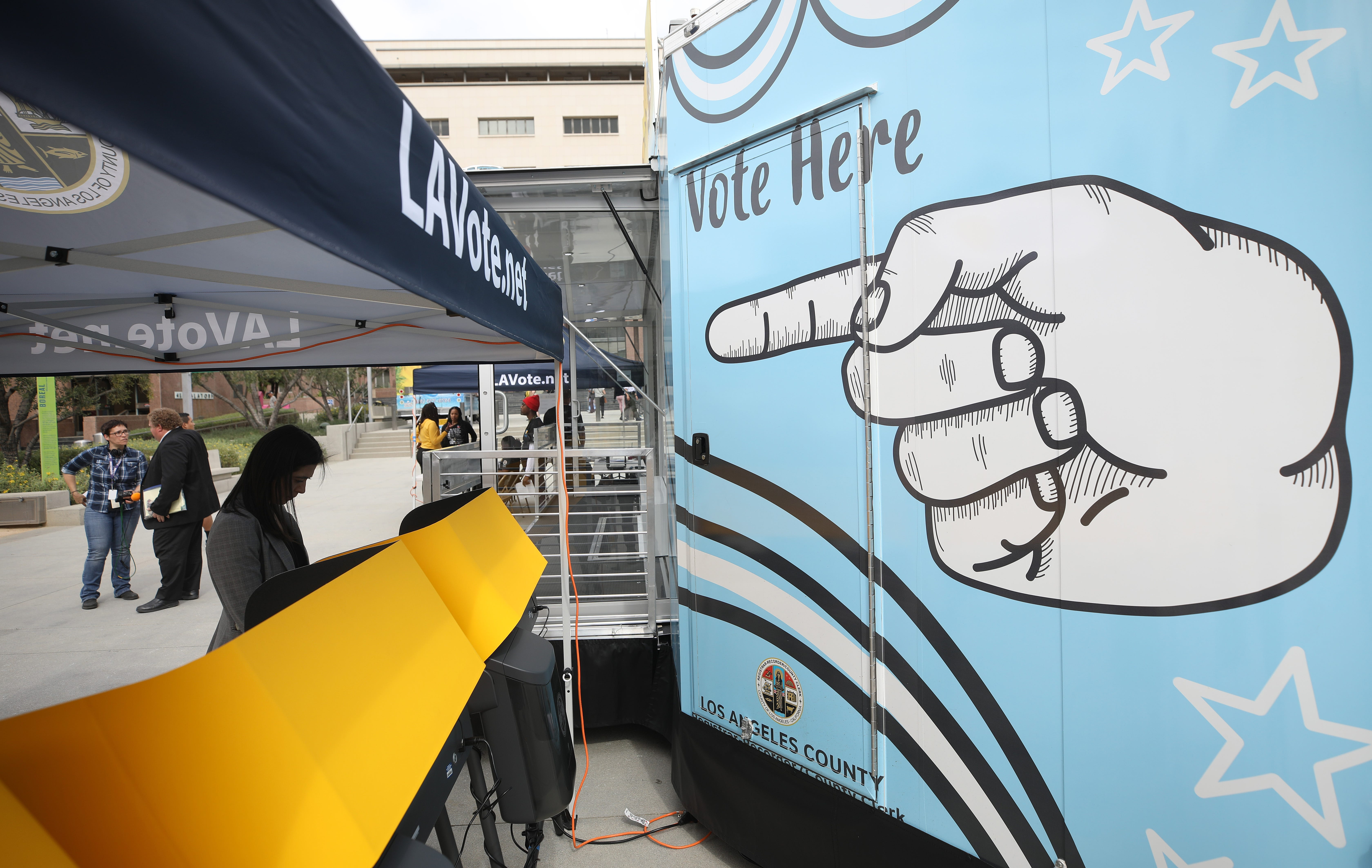 A voter prepares her ballot in a voting booth during early voting for the California presidential primary election at a new L.A. County Mobile Vote Center