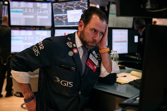 Traders work on the floor of the New York Stock Exchange on Feb. 27, 2020 in New York City.  With concerns growing about how the coronavirus might effect the economy, stocks fell for the fourth straight day. The Dow Jones Industrial Average lost almost 1200 points on Thursday.