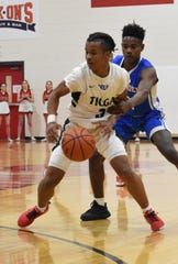 Tioga senior Shermar Nash (3) dribbles the ball against Ellender High School in the first round of the boys basketball playoffs Friday, Feb. 28, 2020. Ellender won 67-52.