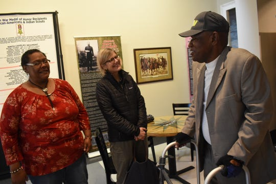 "Linda Rhodes (left) and Elisabeth Keller (center) talk with Army veteran Leroy Smith at the exhibit, ""A Legacy of Honor and Valor"" which was recently at the Alexandria Museum of Art. Smith is the son of World War II veteran Charles N. Smith and one of four of Charles' children who served in the military."