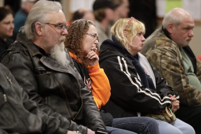 Mourners listen to speakers during a vigil held Friday for William Beyer, 5, and Danielle Beyer, 3, who were found dead by police on Feb. 17 in the upper level of a duplex in Kaukauna.