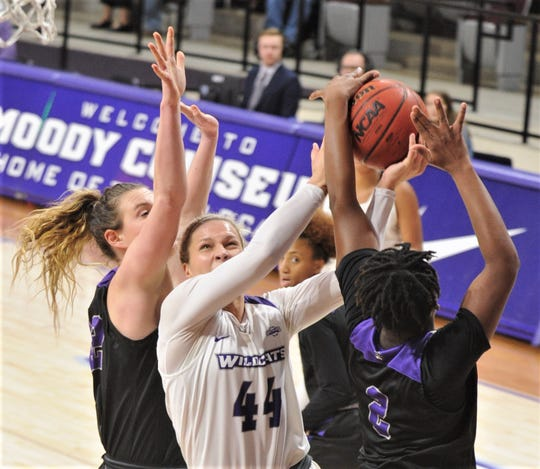 ACU's Lexie Ducat (44) is fouled while driving to the basket against the Central Arkansas defense.