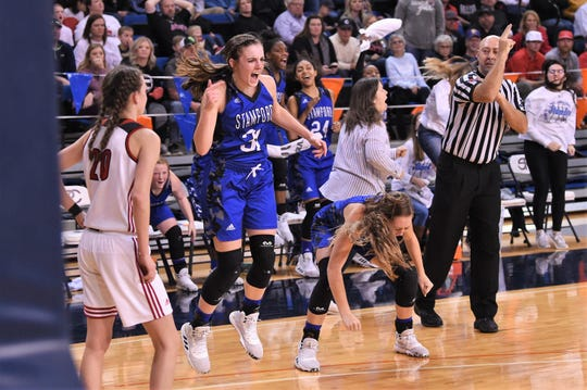 Stamford's Audrey Brewer (31) celebrates and basket and a foul against No. 3 Gruver in the Region I-2A tournament semifinal at South Plains College's Texan Dome in Levelland on Friday, Feb. 28, 2020. The Lady Bulldogs fell 56-45 to end their season.
