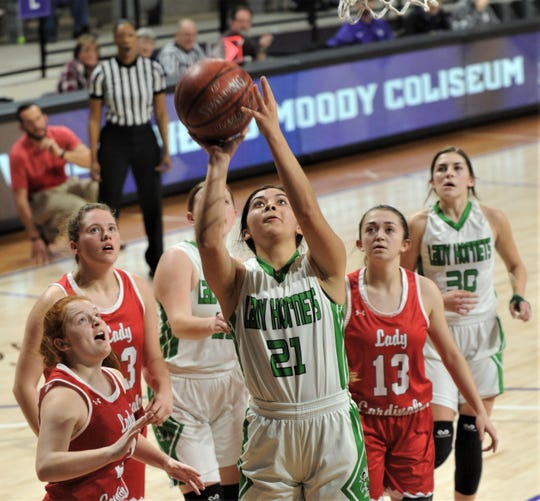 Blackwell's Madison Solis (21) shoots as the Hermleigh defense looks on. Hermleigh won the Region II-1A semifinal game 43-27 on Feb. 28 at ACU's Moody Coliseum.