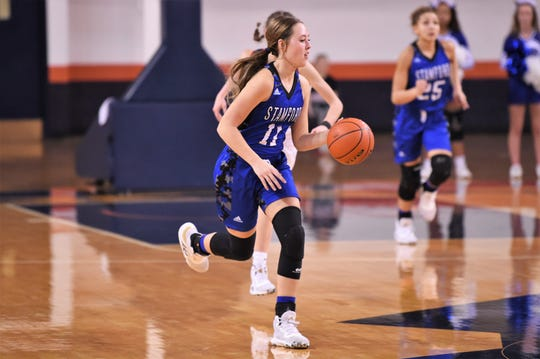 Stamford's Tylee Jo Bevel (11) leads a fast break against No. 3 Gruver in the Region I-2A tournament semifinal at South Plains College's Texan Dome in Levelland on Friday, Feb. 28, 2020. The Lady Bulldogs fell 56-45 to end their season.