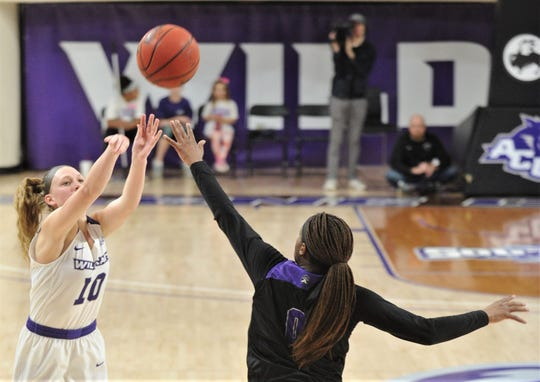 ACU's Breanna Wright, left, shoots a 3-point goal over Central Arkansas' Briana Trigg in the first half during the Southand Conference game Saturday at Moody Coliseum.
