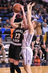 Haskell's Delaney Hanson (23) goes up for a contested shot against No. 10 Panhandle in the Region I-2A tournament semifinals at South Plains College's Texan Dome. The No. 8 Maidens fell 47-24 on Friday, Feb. 28, 2020, to end their season.