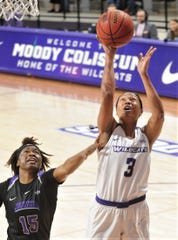 ACU's Dominique Golightly shoots in the paint while Central Arkansas' Terri Crawford defends during the Southland Conference game Saturday, Feb. 29, 2020, at Moody Coliseum.