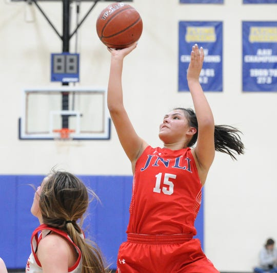Jim Ned junior Alexis Espinosa goes for a shot against Shallowater in a Region I-3A semifinal Friday, Feb. 28, 2020, at Wayland Baptist's Hutcherson Center.