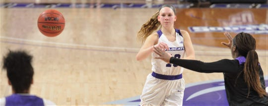 ACU's Breanna Wright, center, passes the ball to a teammate while a Central Arkansas player defends during the Southland Conference game Saturday.