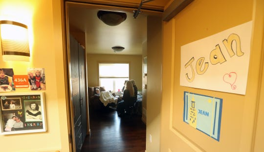 The Agate Pass Threshold Choir sings for resident Jean Cherry in her room at the Madrona House on Bainbridge Island on Friday, Feb. 28, 2020.