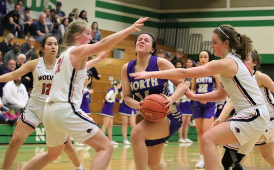 North Kitsap's Noey Barreith tries to get a shot off against Black Hills on Friday.