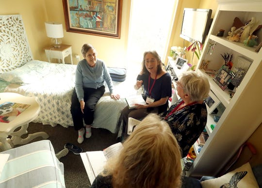 The Agate Pass Threshold Choir members Judy Friesem, Marilyn Price-Mitchell and Nancy Rudman sing for resident Mary Allen (left) at the Madrona House on Bainbridge Island on Friday, Feb. 28, 2020.