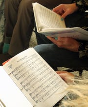 The Agate Pass Threshold Choir sings for residents at the Madrona House on Bainbridge Island on Friday, Feb. 28, 2020.