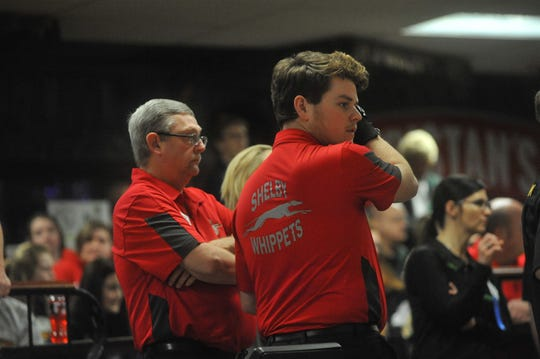 Shelby's Nick Beekman and coach Jamie Williams wait for other bowlers at the state bowling tournament.