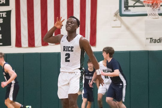Rice's Michel Ndayishimiye (2) celebrates after making a 3-pointer during the boys basketball game between the Burlington Seahorses and the Rice Green Knights at Rice Memorial High School on Friday night February 28, 2020 in South Burlington, Vermont.