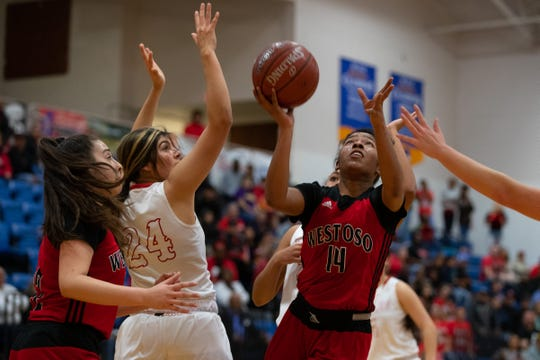 West Oso's Racheal Requenez jumps to make a basket during the second quarter of the girls Class 4A regional semifinal against Salado at the Steinke Physical Education Center in Kingsville on Friday, Feb. 28, 2020.