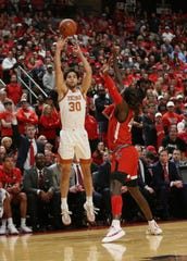 Feb 29, 2020; Lubbock, Texas, USA;  Texas Longhorns forward Brock Cunningham (30) takes a jump shot in front of Texas Tech Red Raiders guard Chris Clarke (44) in the first half at United Supermarkets Arena. Mandatory Credit: Michael C. Johnson-USA TODAY Sports