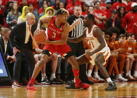 Feb 29, 2020; Lubbock, Texas, USA;  Texas Tech Red Raiders guard Jahmi'us Ramsey (3) looks for an opening against Texas Longhorns guard Courtney Ramey (3) in the first half at United Supermarkets Arena. Mandatory Credit: Michael C. Johnson-USA TODAY Sports