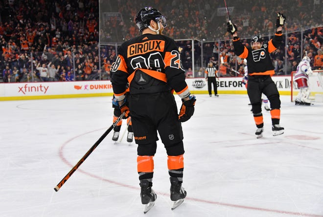 Jake Voracek, right, had four assists on the night. Flyers captain Claude Giroux had a pair of goals in a 5-2 win over the New York Rangers.