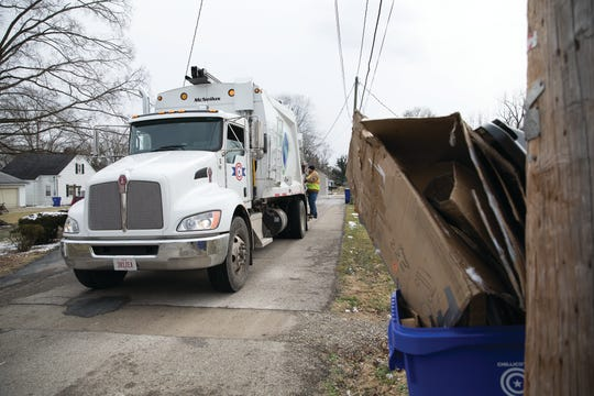 A recycle can filled with broken down boxes awaits to be picked up Friday afternoon by the recycling truck in Chillicoth, Ohio.