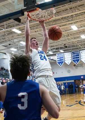 Brandon Noel hangs off the rim after dunking the ball. Chillicothe defeated Marysville 62-48 in a Division I sectional final on Feb. 28, 2020, in Chillicothe, Ohio.