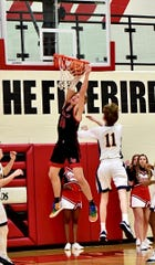 Ayden Schneider gets a throw down for La Salle in the sectional final against Walnut Hills, Feb. 28, 2020, at Lakota West High School.