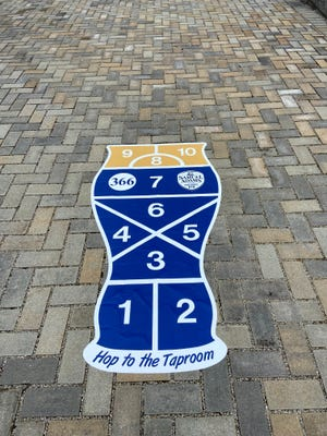"Hidden hopscotch courses in Findlay Market encourage beer enthusiasts to ""hop to the taproom."""