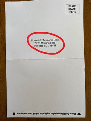 Some Oakland County voters are getting postcards about absentee ballots with the wrong Bloomfield Township clerk.