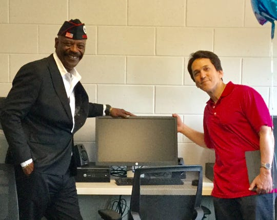 Tyrone Chatman poses with Free Press columnist Mitch Albom at the Michigan Veterans Foundation in Detroit in 2017. Albom's charity, S.A.Y. Detroit, worked with Chatman to build a computer lab for the veterans.