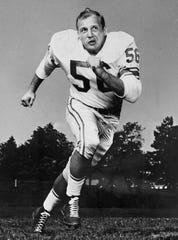 Linebacker Joe Schmidt was the captain of the 1957 NFL champion Detroit Lions.