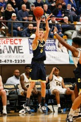 Clarkston's Fletcher Loyer #5 takes a three point shot during the first half.