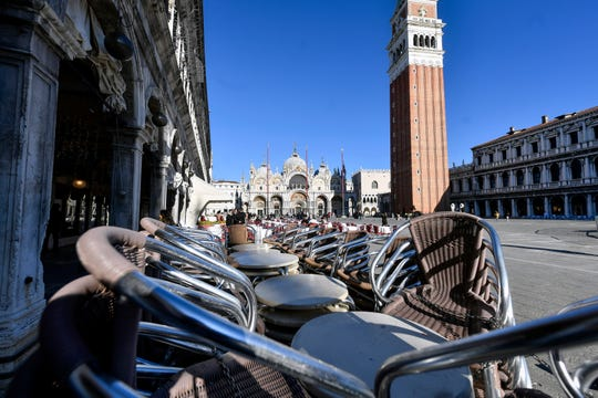 Chairs are lined up at a restaurant in St. Mark's Square in Venice, Italy, Friday.