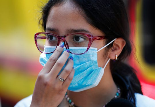 A teen wears a medical mask as a precaution against the spread of the new coronavirus, during an outing in Mexico City, Saturday, Feb. 29, 2020.