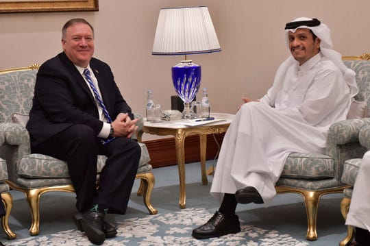 U.S. Secretary of State Mike Pompeo, left, meets with Qatar's Foreign Minister Sheikh Mohammed bin Abdulrahman Al Thani before a peace signing ceremony between the U.S. and the Taliban in Doha on Saturday, Feb. 29, 2020.