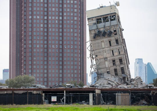 The former Affiliated Computer Services tower core shaft remains standing on Monday, Feb. 17 in Dallas. A demolition left the single tower behind.